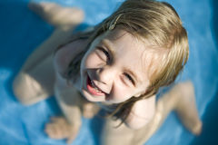 Happy little girl in the pool Stock Images