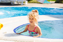 Happy little girl in pool Stock Image