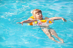 Happy little girl in the pool Stock Photography