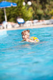 Happy little girl in the pool Royalty Free Stock Photography