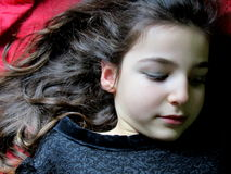 Girl. Portrait of little girl lying with black dress Stock Image