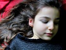 Girl. Portrait of little girl lying with black dress stock image