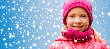 Happy little girl portrait over snow background. Christmas, winter, childhood, and people concept - happy beautiful little girl portrait over snow background Royalty Free Stock Images