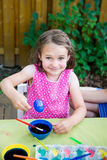 Happy Little Girl Poses with Dyed Blue Easter Egg Stock Photo