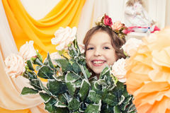 Happy little girl posing with big bouquet of roses Royalty Free Stock Photography