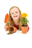 Happy little girl with potted flower Royalty Free Stock Images