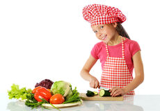 Happy little girl preparing fresh salad. Little girl preparing fresh salad isolated on white Stock Photography