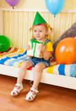 Happy little girl with present Royalty Free Stock Photos