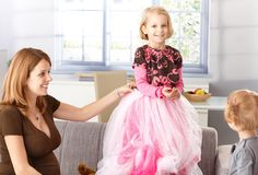 Happy little girl in princess skirt at home Stock Photography