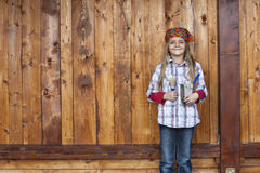 Happy little girl proud to repaint the wood shed Royalty Free Stock Photos