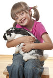 Happy little girl and rabbit Royalty Free Stock Images