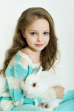 Happy little girl with rabbit Stock Images