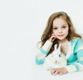 Happy little girl with rabbit Royalty Free Stock Photos