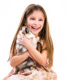 Happy little girl and rabbit Stock Photo