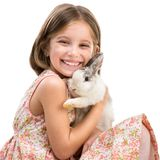 Happy little girl and rabbit Royalty Free Stock Photo
