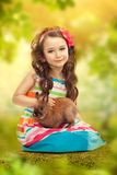 Happy little girl with rabbit. Greeting card Stock Photos