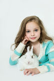 Happy little girl with rabbit Royalty Free Stock Photography