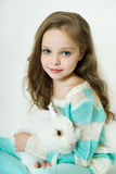 Happy little girl with rabbit Stock Image