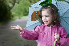 A happy little girl in a rainy day stock photography