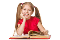 A happy little girl reading a book. Isolated Stock Photography