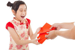 Happy  little girl received red envelope  Royalty Free Stock Image