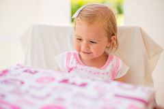 Happy Little Girl After Receiving Birthday Present Royalty Free Stock Photos