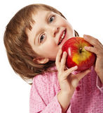 Happy little girl with red apple Stock Photos