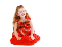 Happy little girl in red dress with curly hair Stock Photo