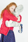 Happy Little Girl with Red Hair Playing with Big Toy Stock Images