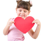 Happy little girl with red heart Stock Images