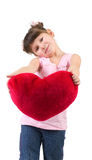 Happy little girl with red heart Stock Photo