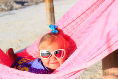 Happy little girl relaxed in hammock Stock Images