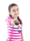Happy little girl with remote control. Watching tv on white background Royalty Free Stock Image