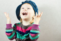 Happy little girl rises up her hands. With delight Royalty Free Stock Photography
