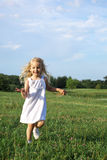 Happy little girl running Royalty Free Stock Photo