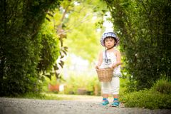 Happy little girl running with basket the garden farm royalty free stock photography