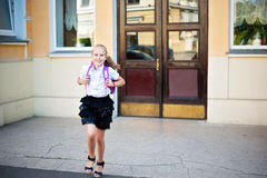 Happy little girl running home from school Royalty Free Stock Photography