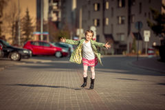 Happy little girl running  from school Royalty Free Stock Photos