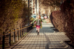 Happy little girl running  from school Royalty Free Stock Image