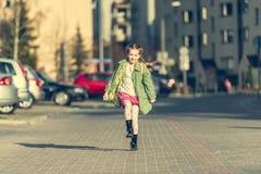 Happy little girl running  from school Stock Image