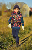 Happy little girl running in sunlight Royalty Free Stock Photos