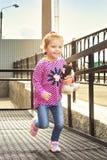 Happy little girl runs towards. Royalty Free Stock Photography