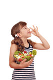 Happy little girl with salad and ok sign Stock Images