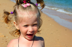 Happy little girl on sand beach Royalty Free Stock Images