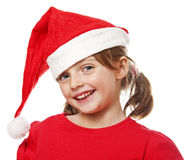 Happy little girl with santa cap Royalty Free Stock Images