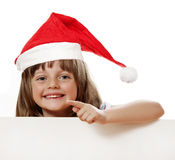 Happy little girl with santa cap Stock Image