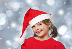 Happy little girl with santa cap Royalty Free Stock Photos