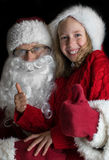 Happy little girl with Santa Claus. Stock Image