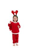 Happy little girl in santa costume Stock Images