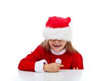 Happy little girl in Santa costume royalty free stock photography